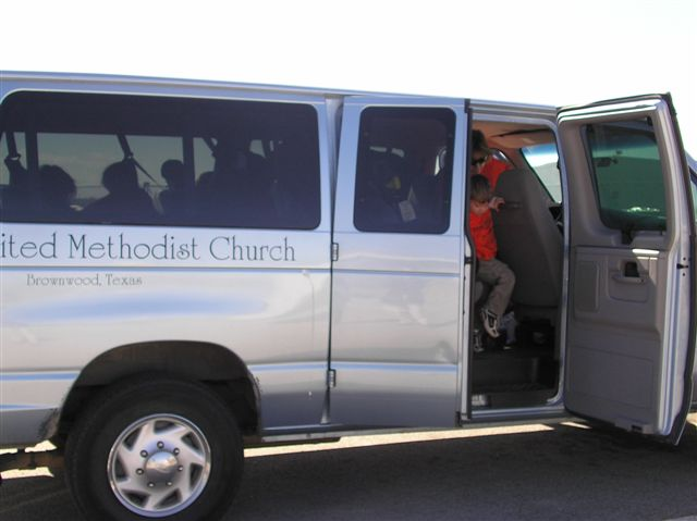 Children begin getting out of the white United Methodist Church van before the tour.